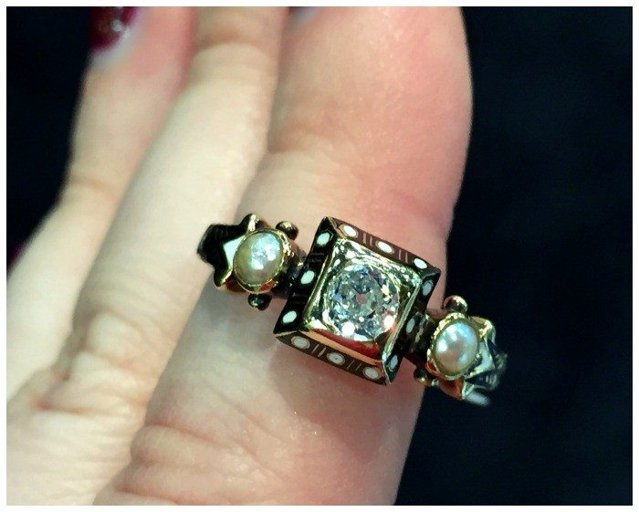 Front view of a beautiful Renaissance revival diamond ring in gold with black and white enamel details. At Roy Rover.