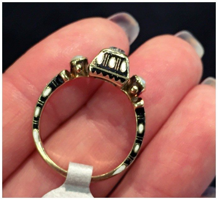 Side detail of a stunning Renaissance revival diamond ring in gold with black and white enamel details. At Roy Rover.