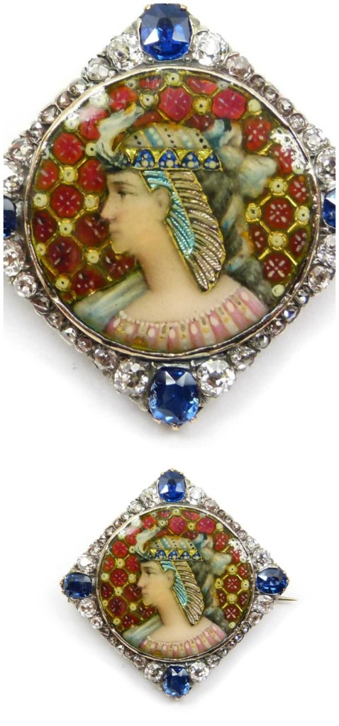 A Victorian Egyptian Revival antique portrait brooch in enamel with diamonds and sapphires. Circa 1870.