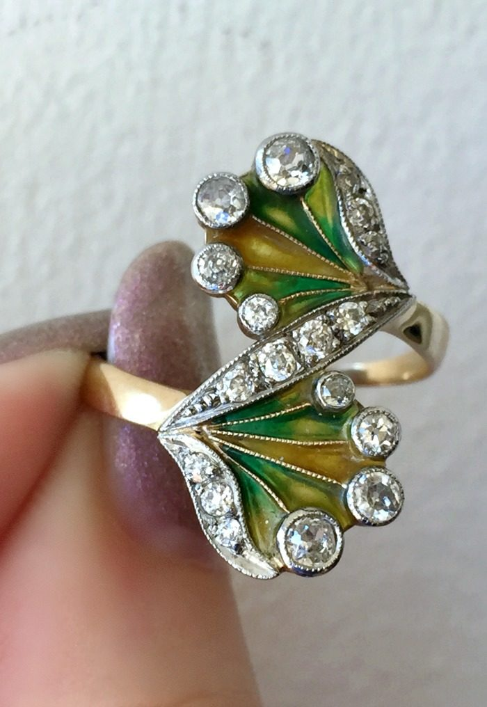 A stunning Art Nouveau ring featuring plique-a-jour enamel and diamonds. At A Brandt and Son.