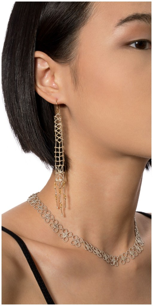 The Cleopatra earrings and the Nofret necklace, both by Sophie Ratner jewelry.