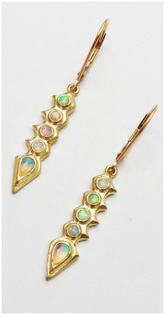 The Opal Spine earrings from Lisa Kim's newest jewelry collection, The Seabeast. Opals in yellow gold.