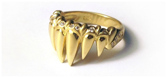 The glamorous tooth ring in gold with diamonds. From Lisa Kim's newest collection of jewelry, The Seabeast.