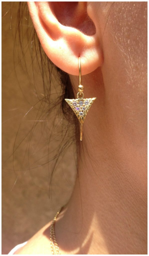 The pave Scale earrings in gold with diamonds. From Lisa Kim's newest jewelry collection, The Seabeast.
