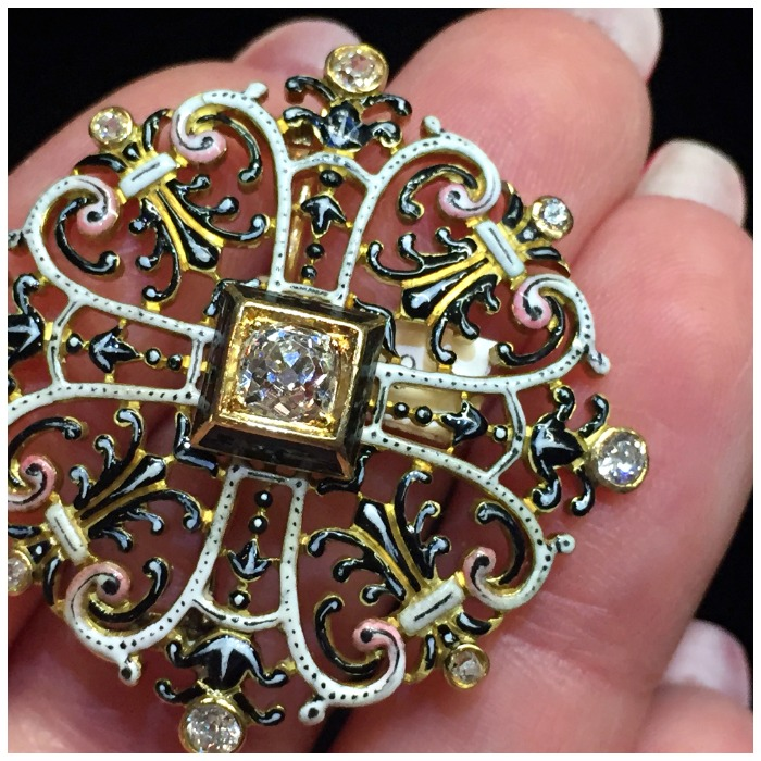 A stunning Renaissance Revival brooch from Humphrey Butler. Enamel on gold with diamonds.