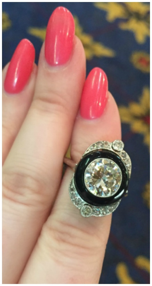 This Art Deco-esque ring (exact age unknown) features a perfect black onyx circle surrounding a 2.05 ct. diamond. At Simon Teakl