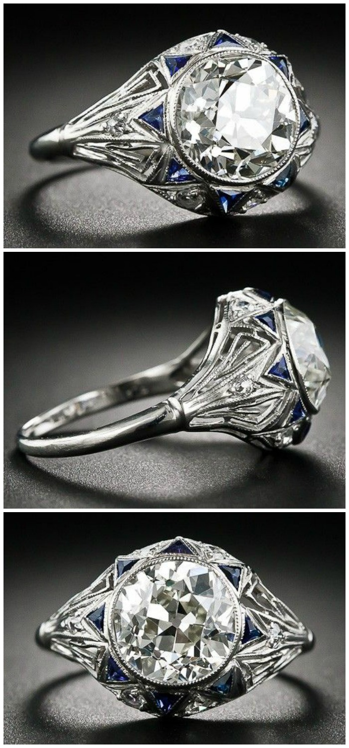 A beautiful antique Art Deco engagement ring with a 2.42 carat center stone, geometric openwork detail, and accent sapphires. At Lang Antiques.