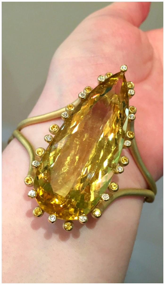A glorious cuff by Suzy Landa with an 80 carat gemstone!