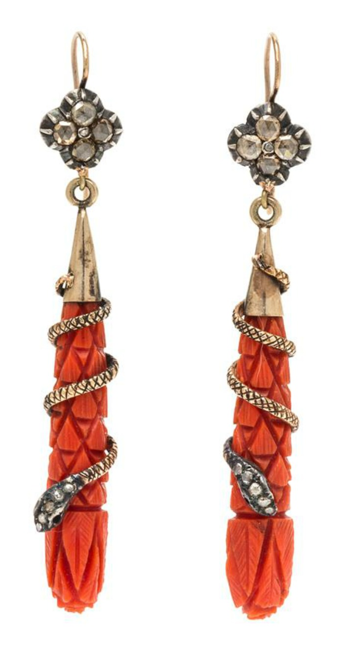 A beautiful pair of antique Victorian era earrings with carved coral and diamond snakes.