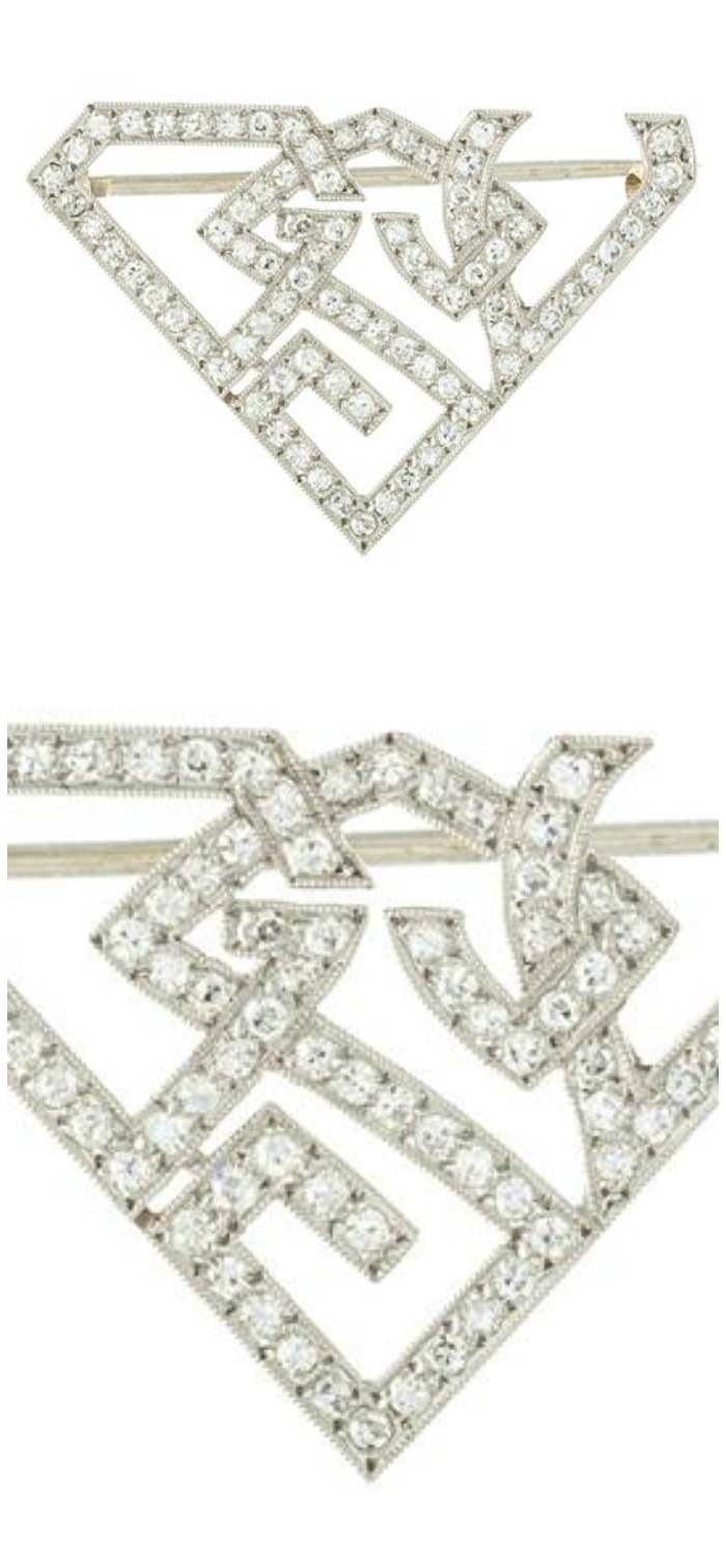 An Art Deco Platinum and Diamond Monogram Brooch, in an openwork geometric frame motif, depicting the letters GSV in an interlocking motif