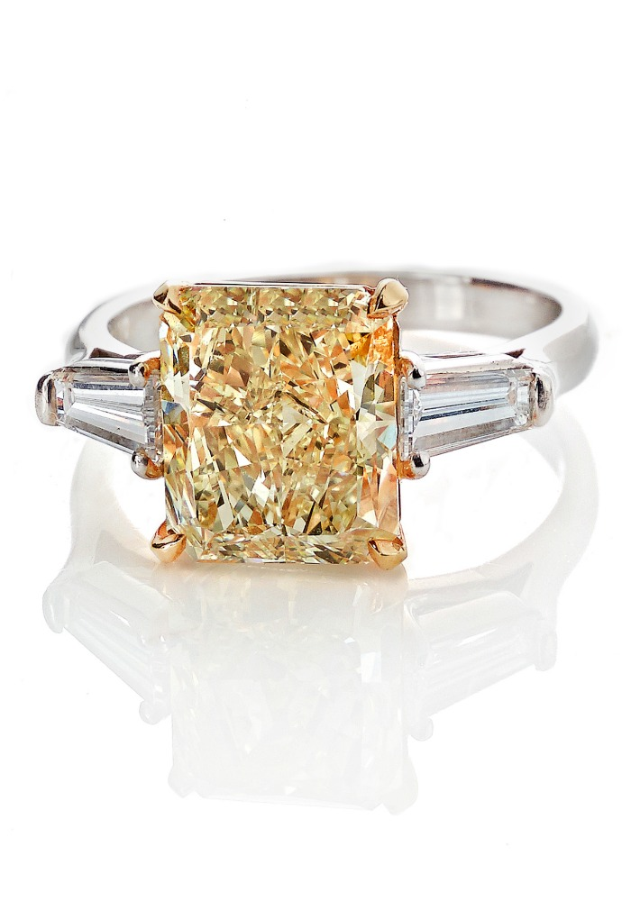Forevermark fancy yellow radiant cut diamond ring.