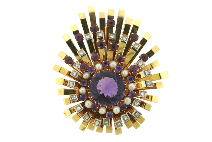 This glamorous retro brooch features amethyst, tourmaline, pearls, and diamonds in gold. At Oakgem.