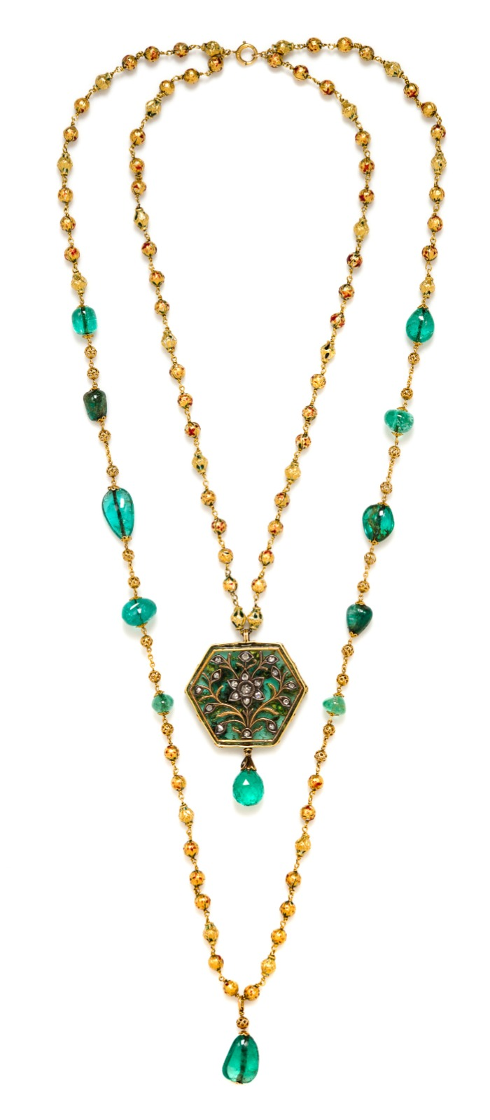 A double-strand Indian necklace with gold beads, emeralds, rubies, and an incredible natural hexagonal emerald with ruby, diamond, and gold details.