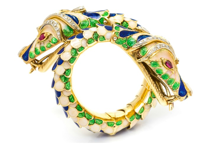 An exceptional vintage yellow gold ,diamond, ruby, and colorful enamel twin chimera bracelet.