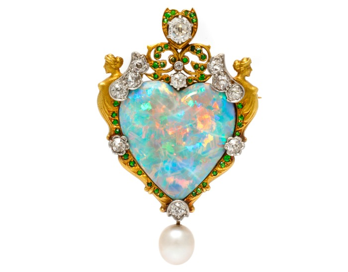 An important Renaissance Revival pendant brooch by Paulding Farnham for Tiffany & Co., with a large opal, diamonds, demantoid garnets set in gold and platinum.