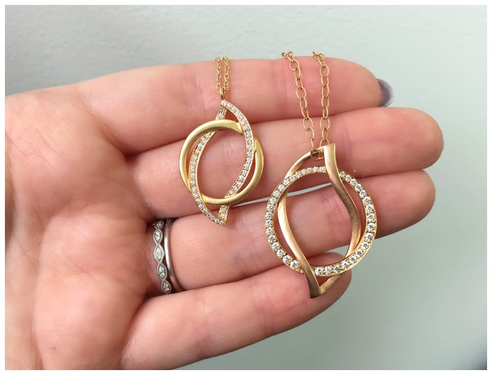Two lovely gold and diamond pendants by Carelle.