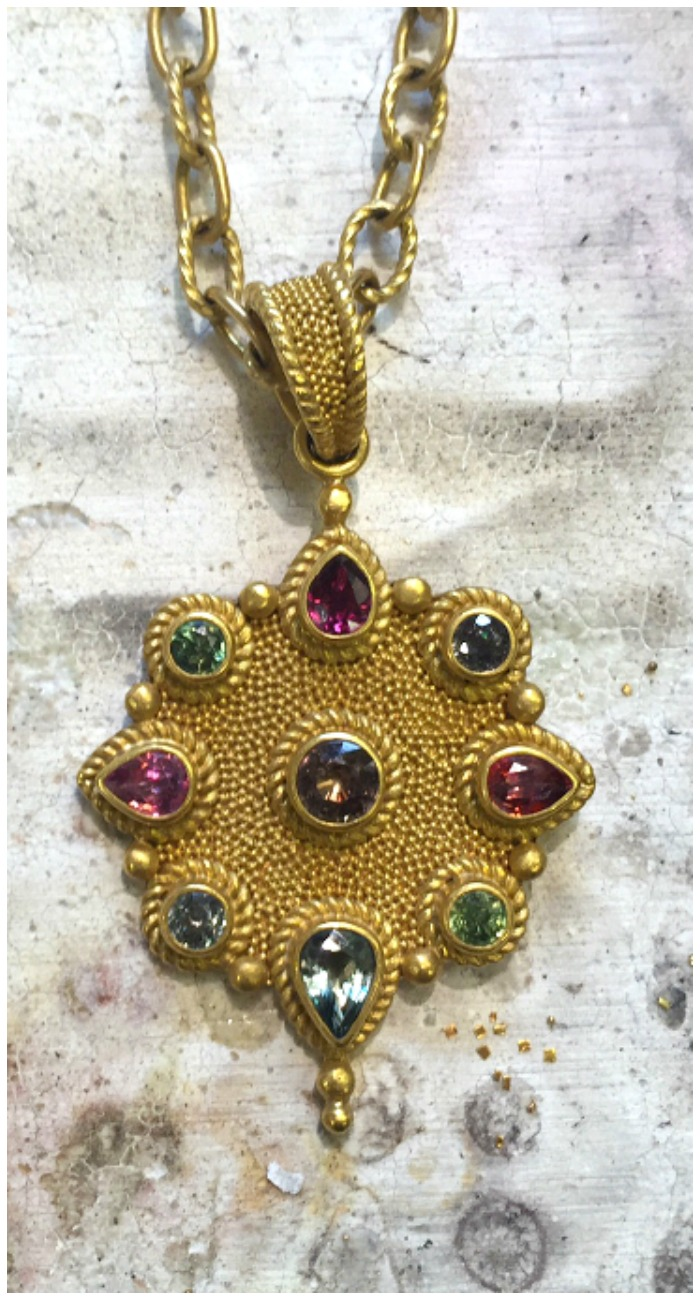 A stunning textured gold and gemstone necklace handmade by Reinstein Ross.