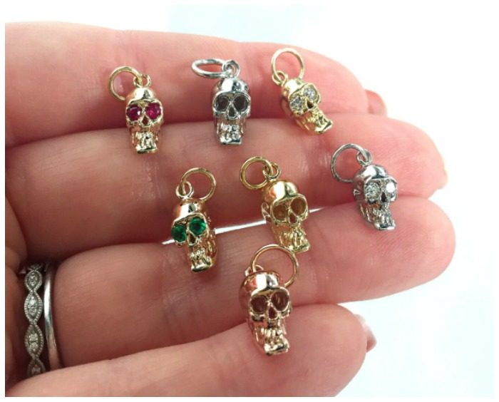 A handful of Alexis Kletjian skull charms in gold with diamonds or gemstones. Spotted at Metal and Smith.