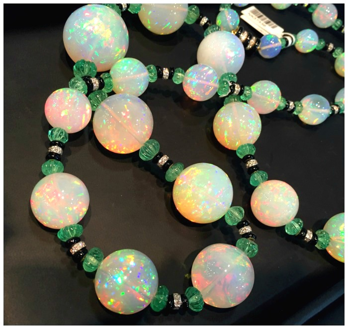A magnificent David Webb necklace with huge Ethiopian opals, carved emerald beads, onyx, and diamonds. At John T Haynes.