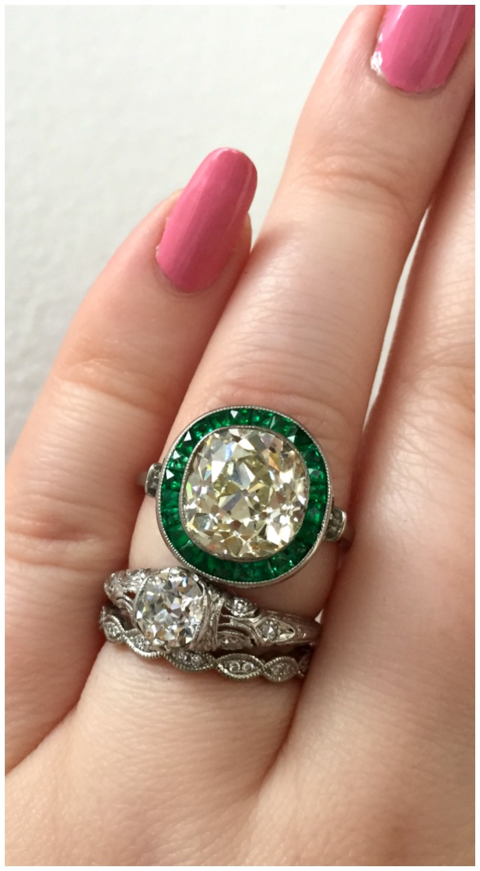 A stunning antique engagment ring from Jewels by Grace, with a delicious antique center stone and an emerald halo. Spotted at Metal and Smith.