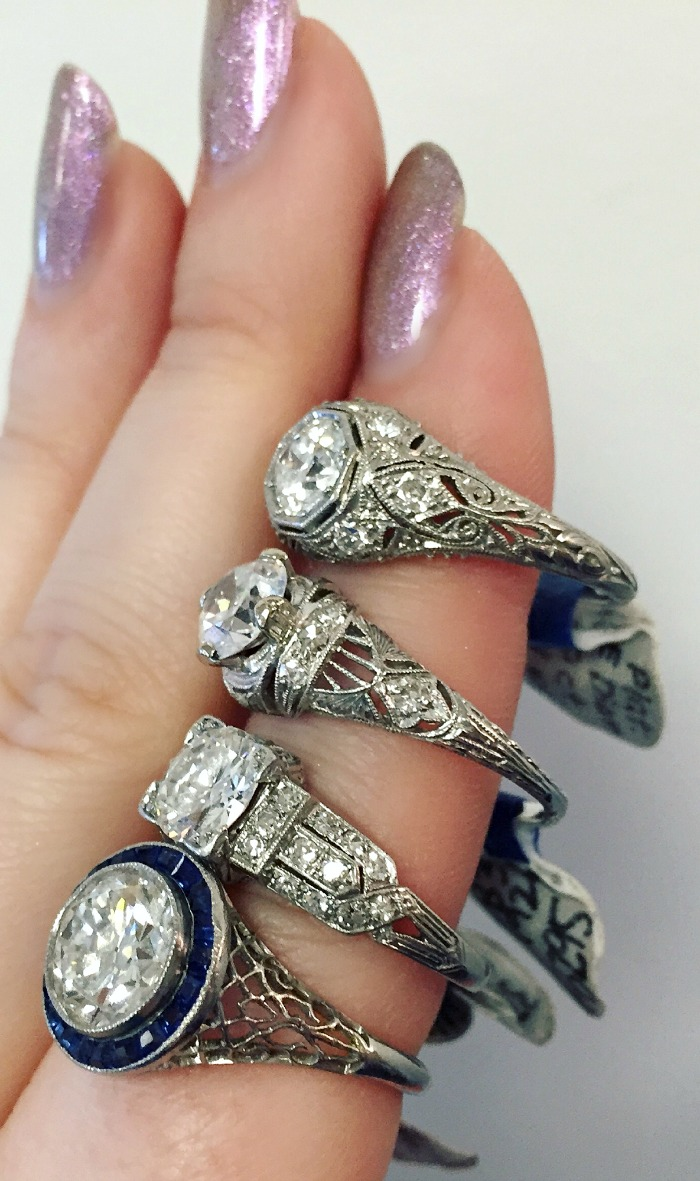 Four stunning Art Deco engagement rings from A Brandt and Son. With diamonds, sapphires, and filigree details.