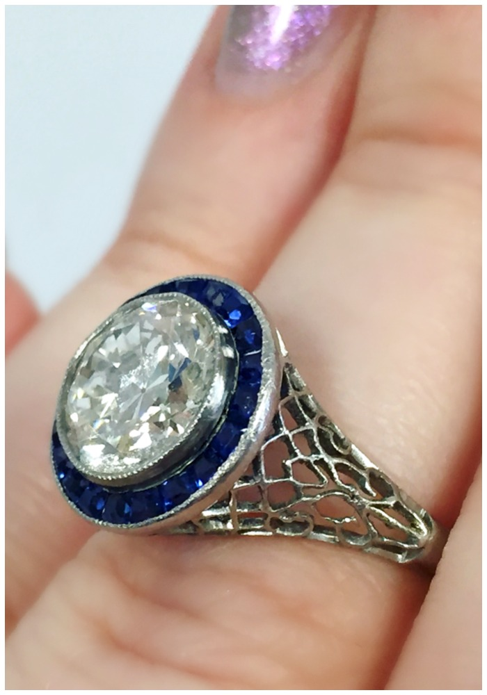 Stunning details on an Art Deco sapphire and diamond engagement ring with filigree details. At A Brandt and Son.