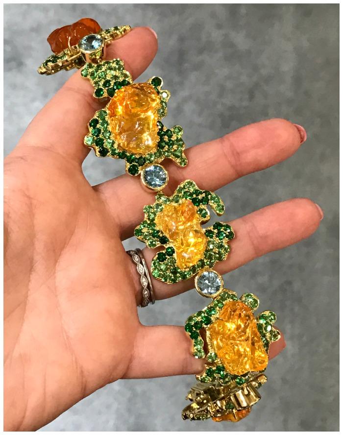 The Queen of Tiye fire opal bracelet by Paula Crevoshay, with fire opals set among blue zircons and green tsavorite garnets.