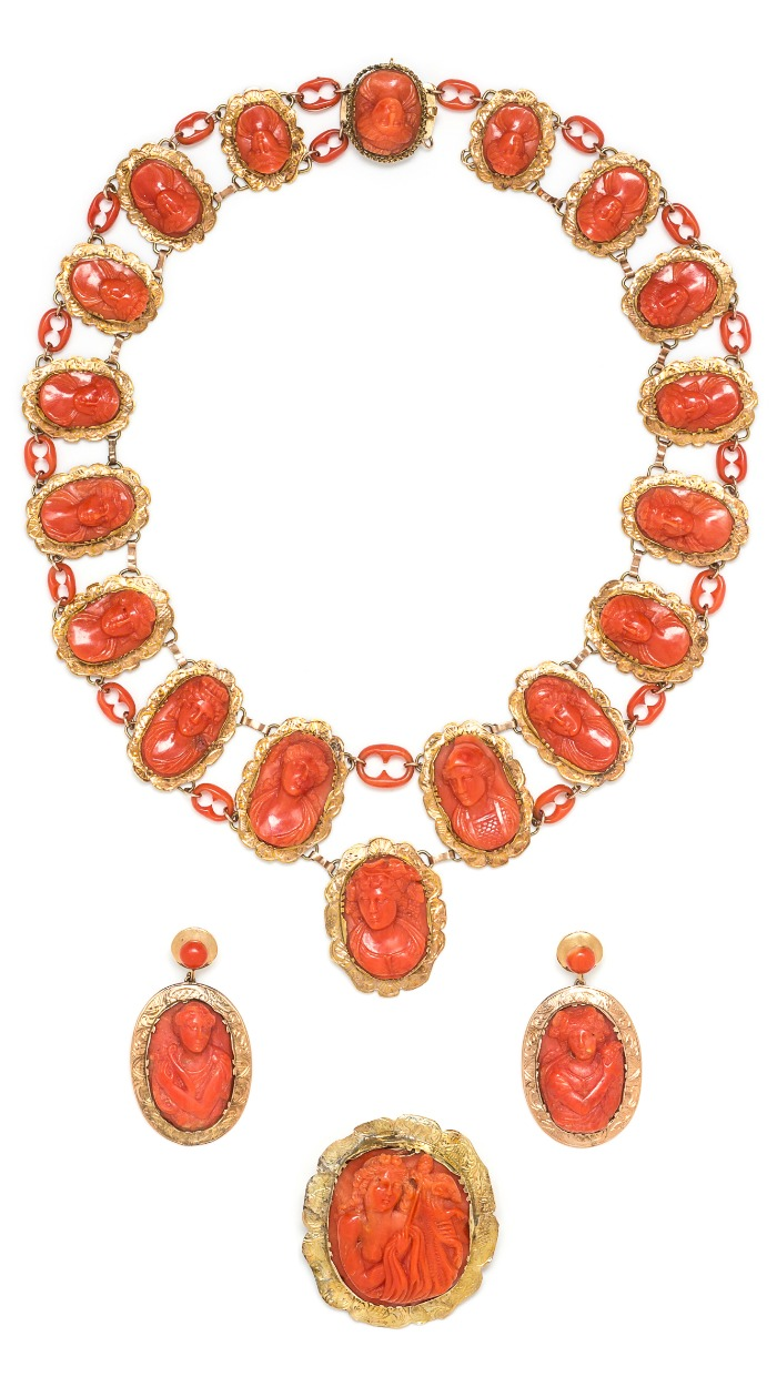 A vintage demi parure all made up of coral cameos and yellow gold! Beauty from the Victorian era.