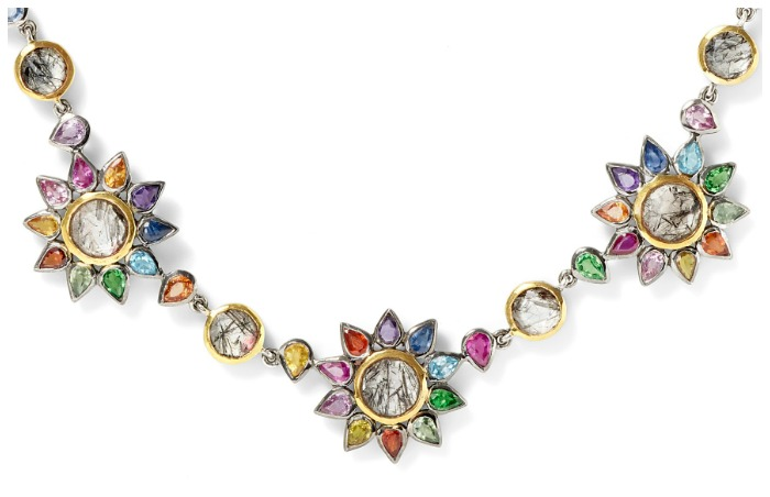 Detail of the beautiful Daisy Chain necklace by SheBee, with brightly colored sapphires and tourmillated quartz in silver and gold.
