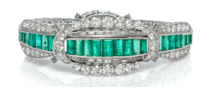 I love the Art Deco lines of this emerald and diamond bracelet in platinum. That's almost 10 carats of diamonds, too! A major piece.