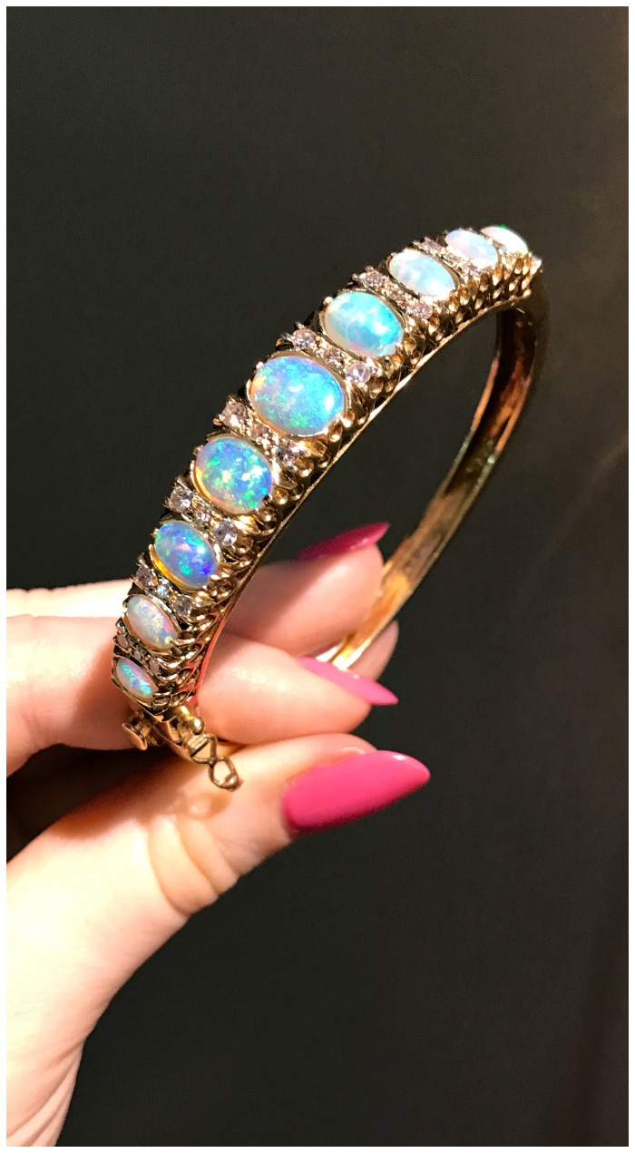 I love the delicate beauty of this opal and diamond bangle. Seen at Maryanntiques at the Original Miami Antique Show.