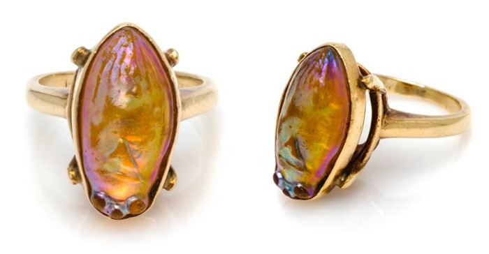 This iridescent glass scarab ring is made of gold and dates to the yeat 1900. A great example of Egyptian Revival jewelry.