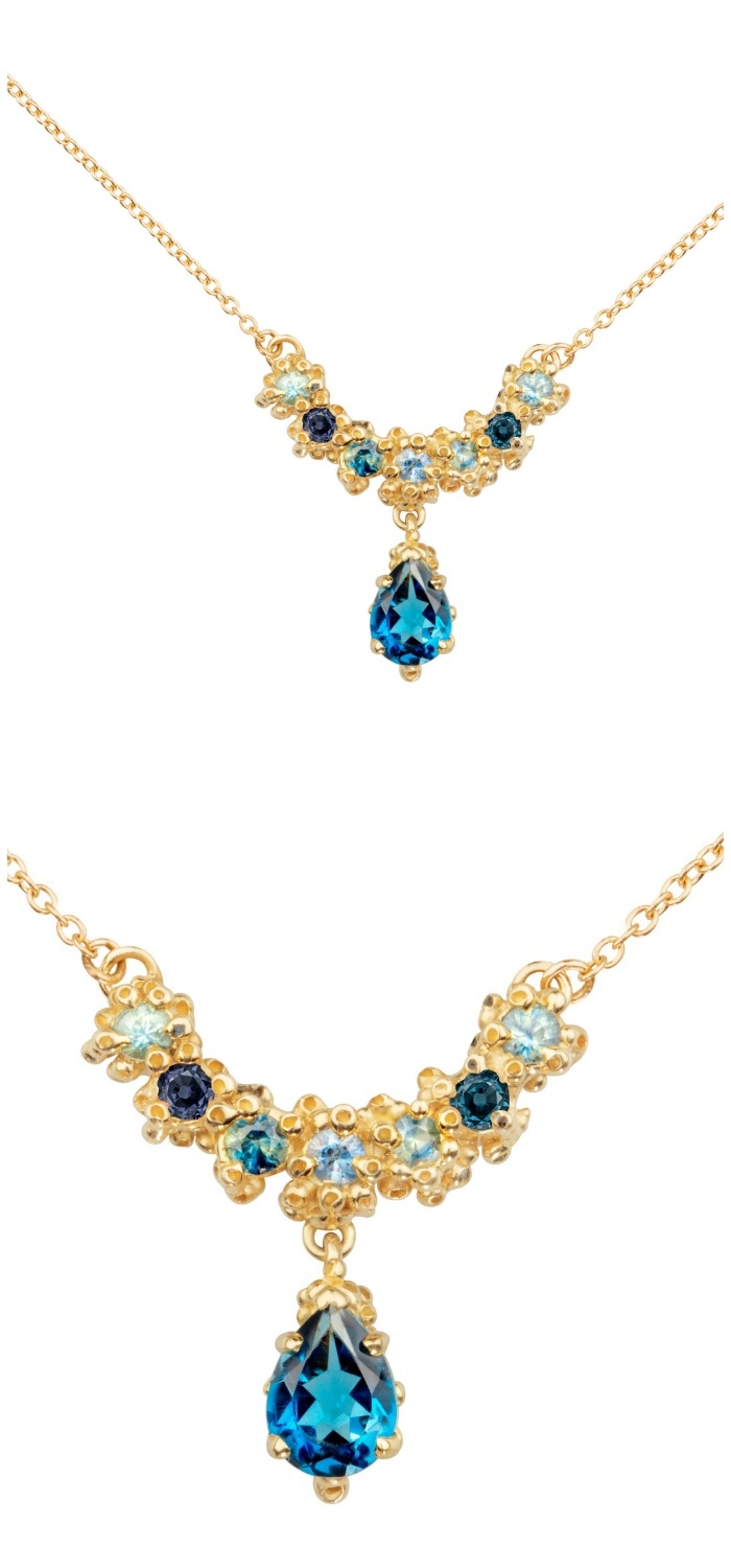 A beautiful handmade necklace by Ruta Reifen, with blue sapphires and topaz stones.
