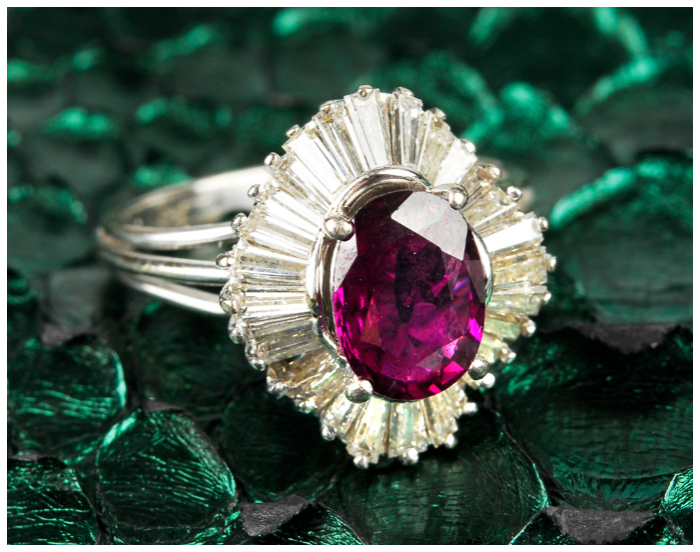 A wildly beautiful ruby and diamond ring! This kind of style is called a ballerina setting.
