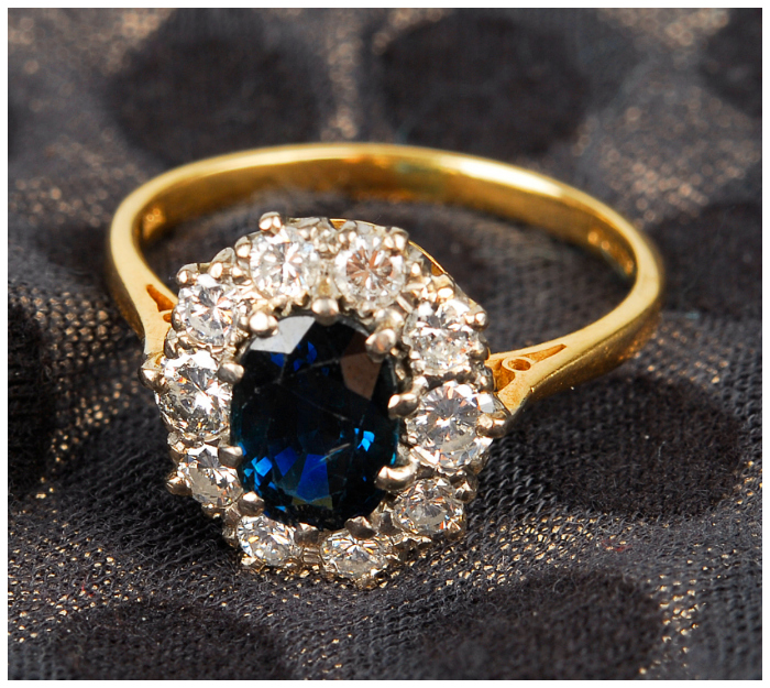 If you admire Kate Middleton's classic style, you'll love this 18k yellow gold sapphire and diamond cluster ring.