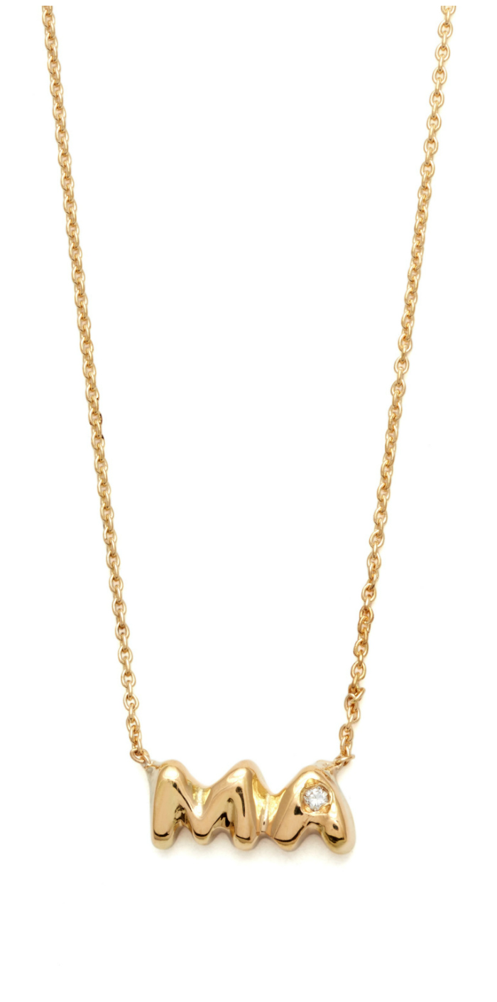 A necklace from Elisa Solomon's Mama jewelry collection in yellow gold with diamonds.