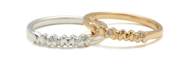 A yellow gold and a white gold ring with diamonds, from Elisa Solomon's Mama jewelry collection.