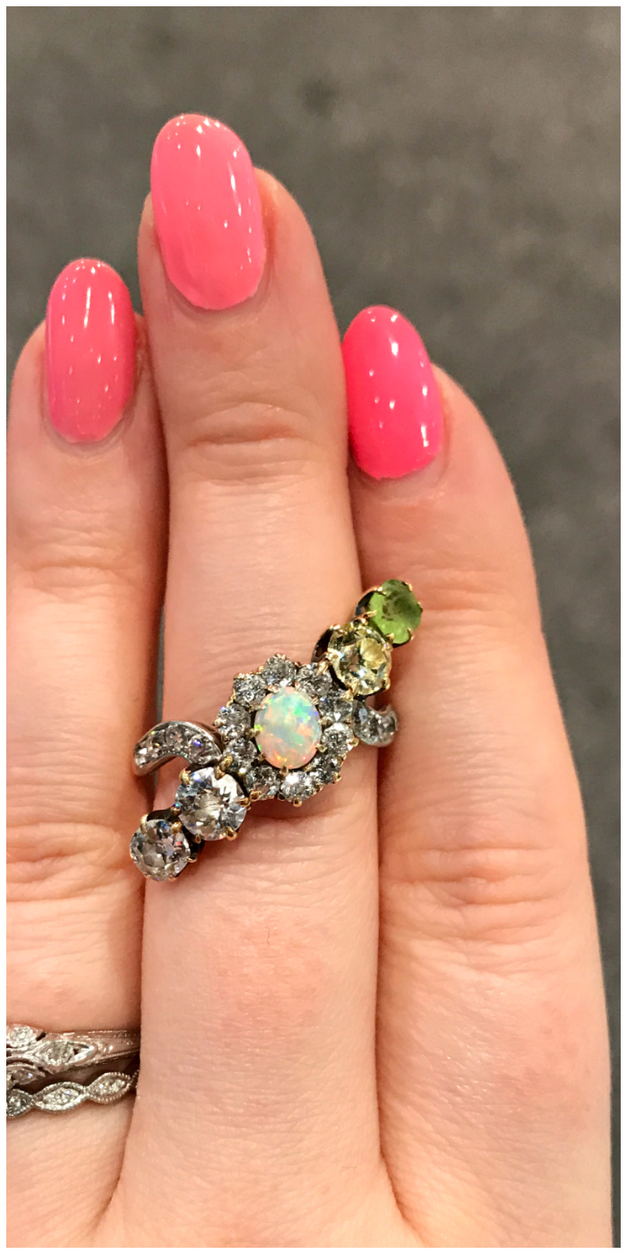 A fabulous, unusual antique ring with diamonds, an opal, a peridot and one yellow diamond. At Steve Fishman.