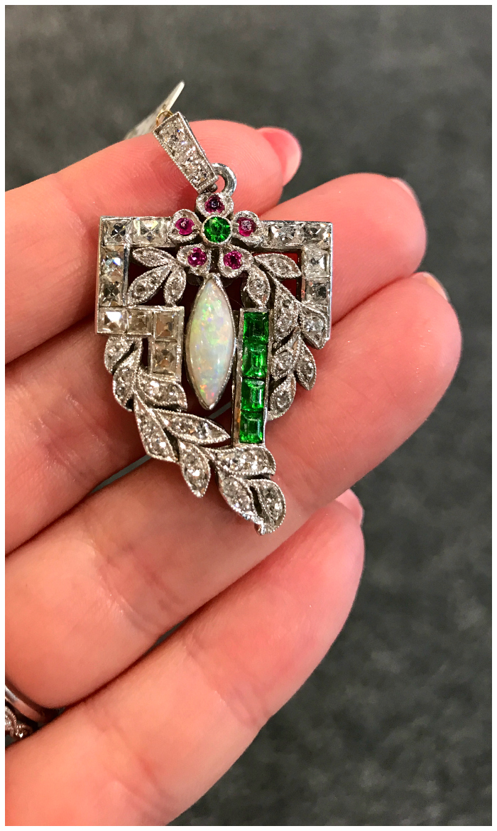 An Edwardian era diamond, opal, and demantoid garnet pendant from Moira Jewelry. Beautiful!