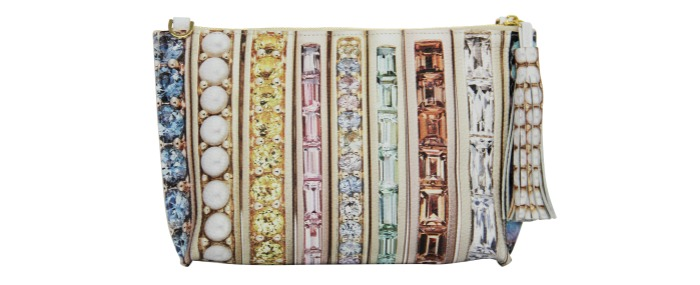 A gemstone printed leather clutch bag from Paige Gamble's Jane Taylor Jewelry collaboration.