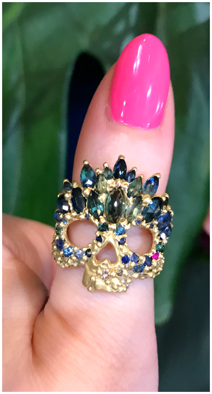 I absolutely love these skull rings! Diamonds and colorful gemstones in yellow gold, by Polly Wales.