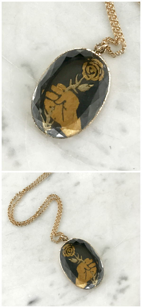 A beautiful necklace in oxidized sterling silver and gold, by Acanthus.