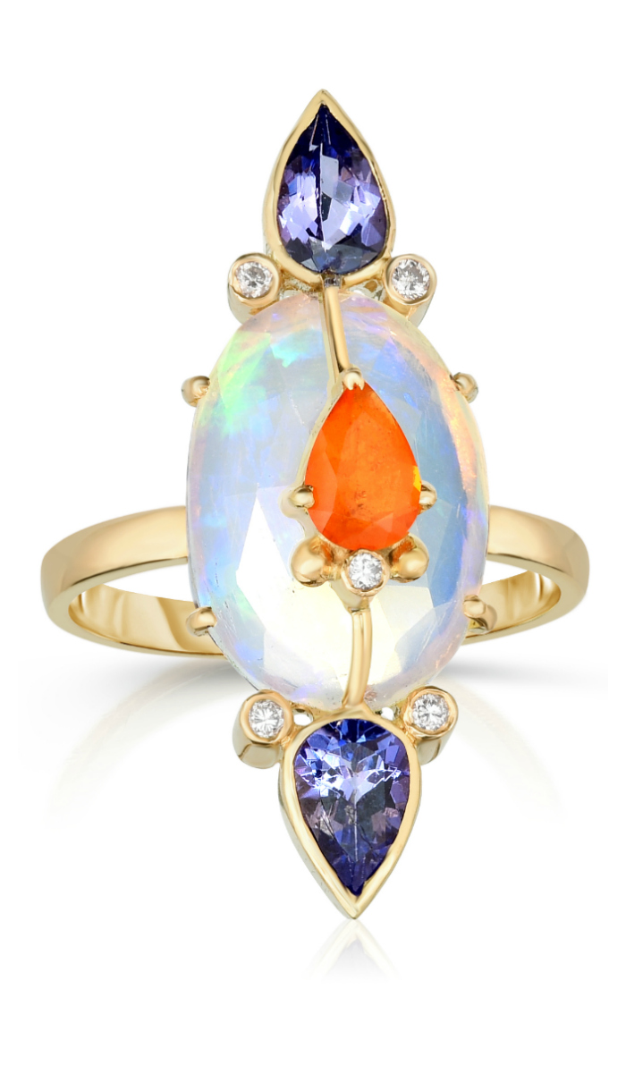 A beautiful opal ring by Loriann Jewelry. With sapphire, tanzanite, and diamond accents.