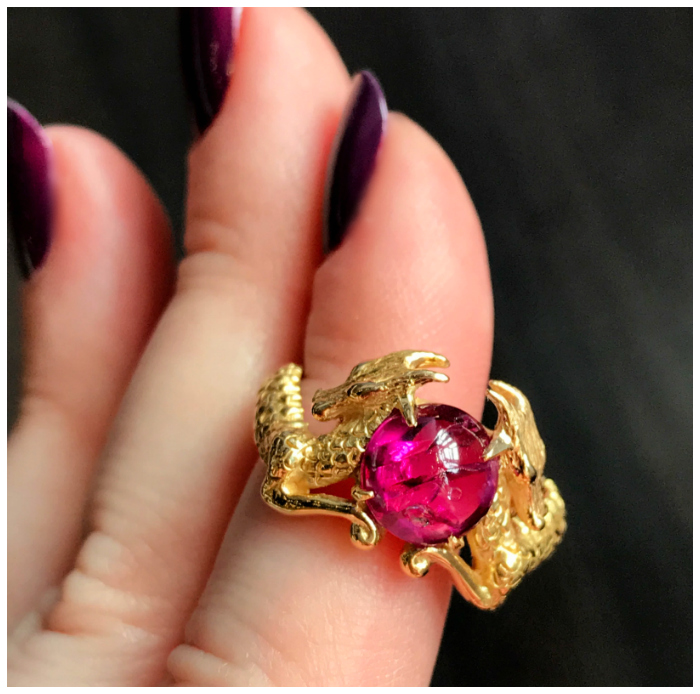 A stunning one of a kind ring by Hunt Country Jewelers, with beautifully detailed dragons and a vivid Burmese ruby cabochon gemstone.