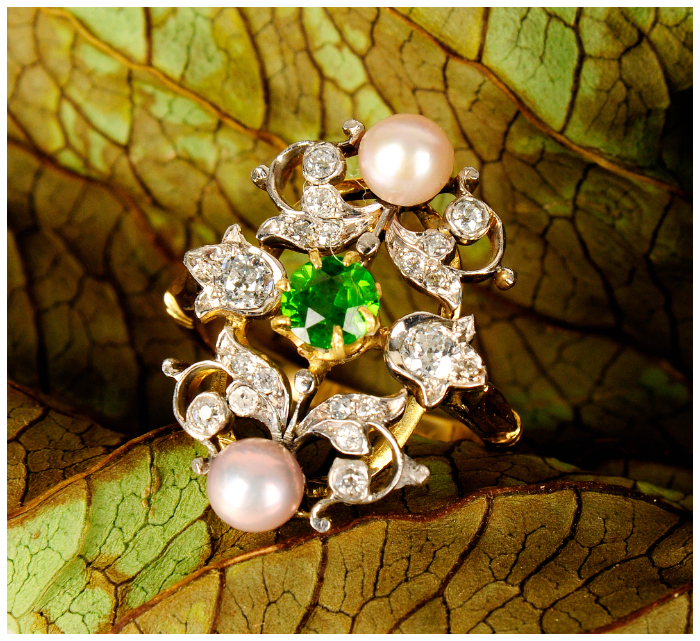 A beautiful antique demantoid garnet, diamond and seed pearl dress ring.
