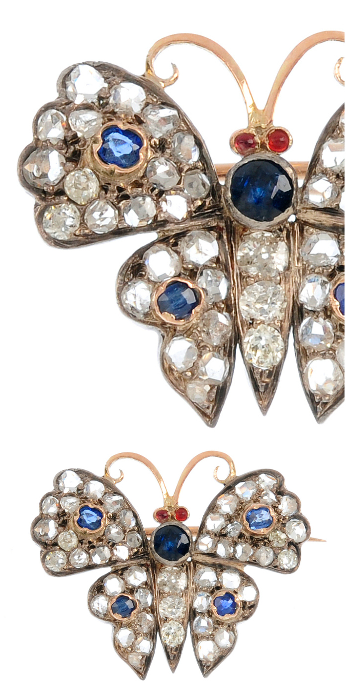 A diamond and sapphire butterfly brooch.