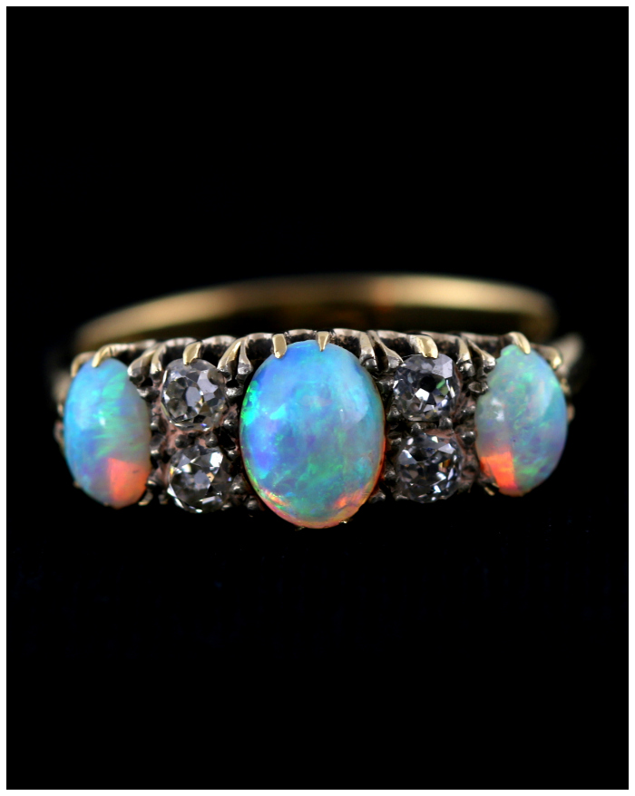A lovely antique opal three stone and diamond ring from Lillicoco.