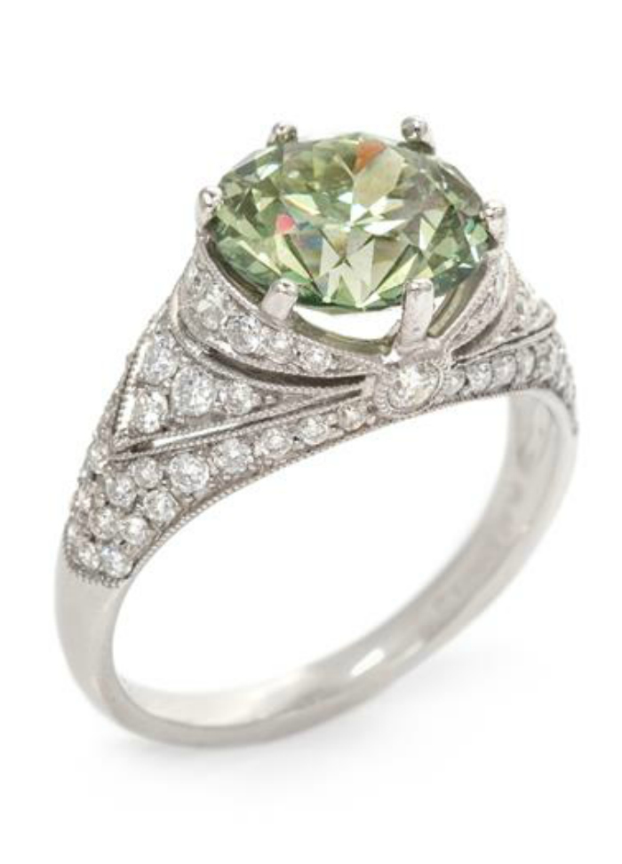 A lovely platinum engagement ring by Sophia D with a rare green diamond in the center (2.98 carat center stone).