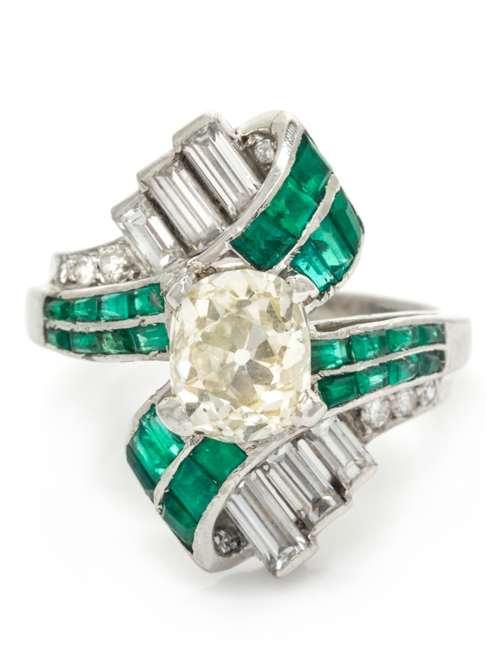I love this Art Deco ring! Emeralds and diamonds in platinum. That's a 1.63 carat center diamond.