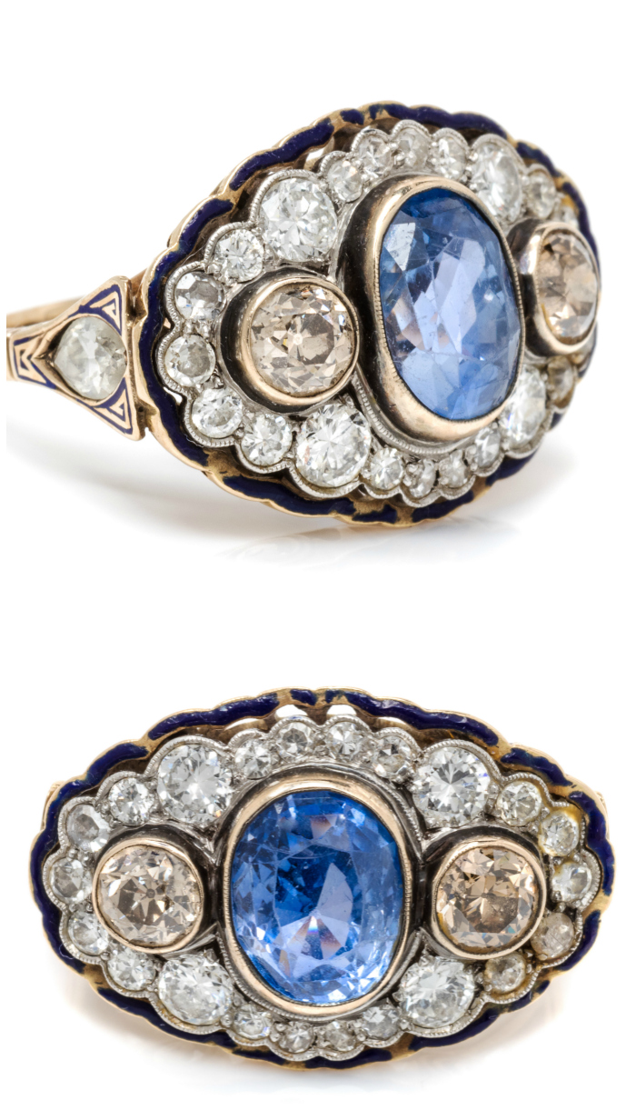 This beautiful antique ring features a lovely sapphire accented with diamonds and blue enamel in platinum and gold.